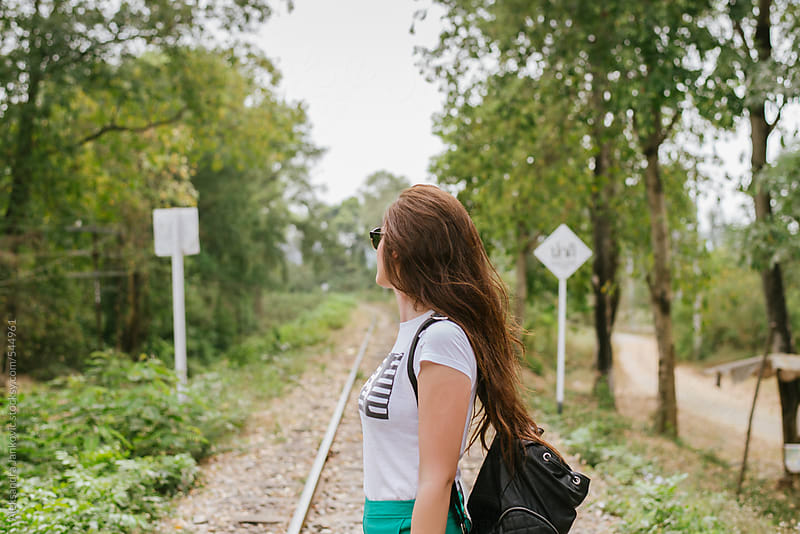 Young woman with backpack exploring the nature by Aleksandra Jankovic for Stocksy United