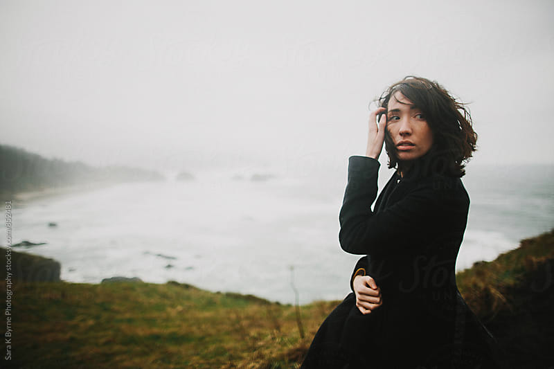 Girl at the ocean on a windy day by Sara K Byrne Photography for Stocksy United
