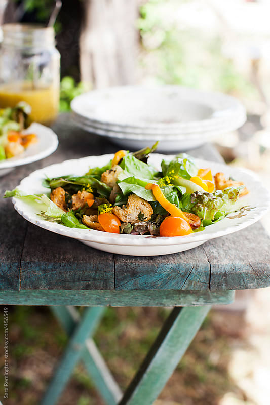 Salad on Farm Table by Sara Remington for Stocksy United
