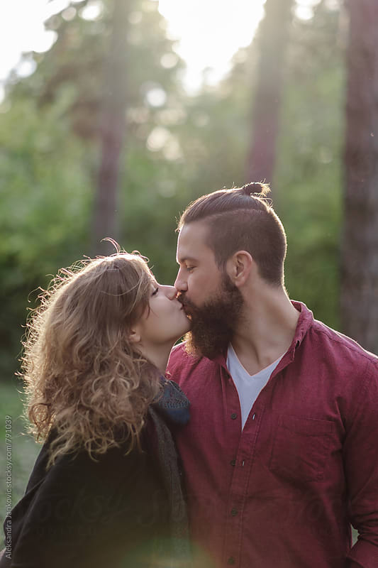 Happy Young Couple Kissing by Aleksandra Jankovic for Stocksy United