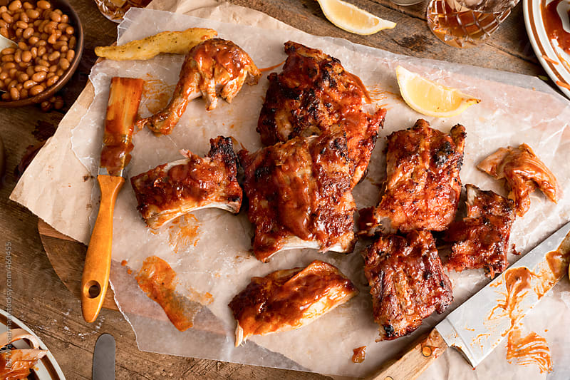 Messy Meal: Barbeque Ribs and Chicken by Jeff Wasserman for Stocksy United