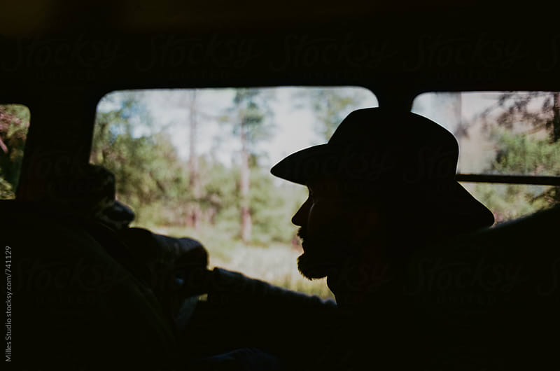 People in a truck traveling off road by Milles Studio for Stocksy United