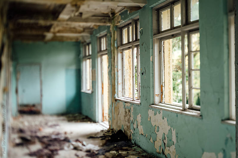 Corridor in an abandoned hospital by Pixel Stories for Stocksy United