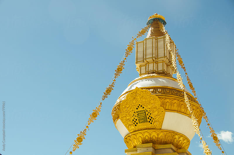A Buddhist temple decorated with gold by Andy Campbell for Stocksy United