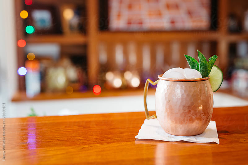 Moscow Mule on the bar by Danny Pellissier for Stocksy United