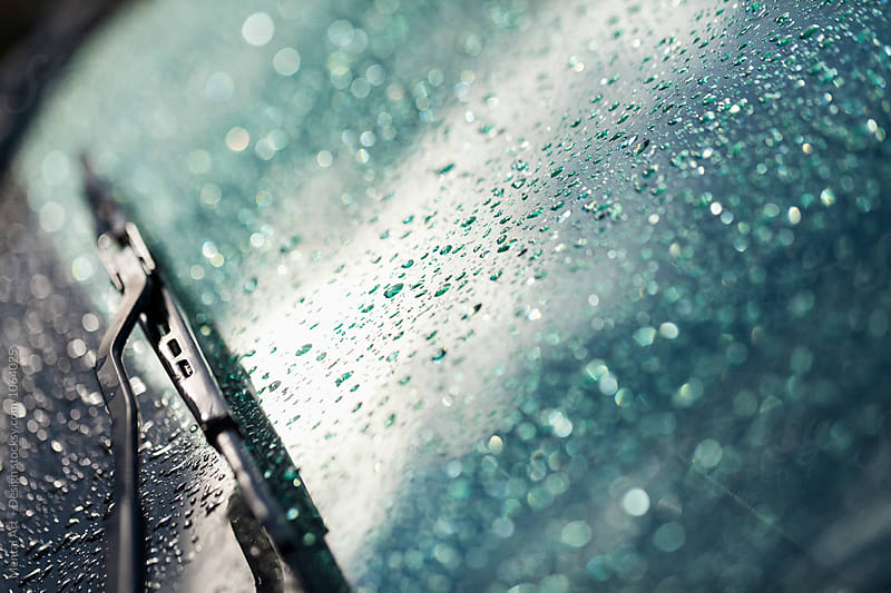 Car windshield in the rain by Mental Art + Design for Stocksy United