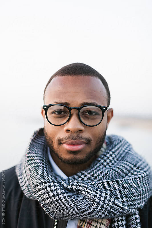 Portrait of an african american man wearing scarf on winter. by BONNINSTUDIO for Stocksy United