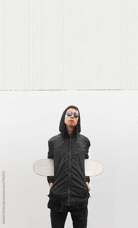 MInimalist portrait of skateboarder. by Audrey Shtecinjo for Stocksy United