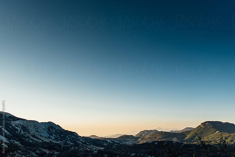 Beautiful sunrise over the mountains by Boris Jovanovic for Stocksy United