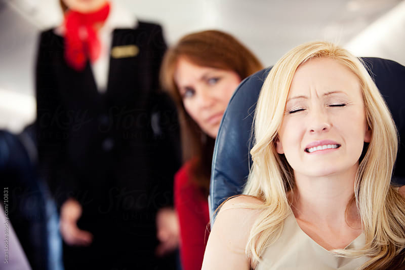 Airplane: Woman Scared of Flying by Sean Locke for Stocksy United