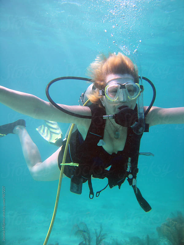 Woman in her sixties scuba diving in the Caribbean by Jovana Milanko for Stocksy United