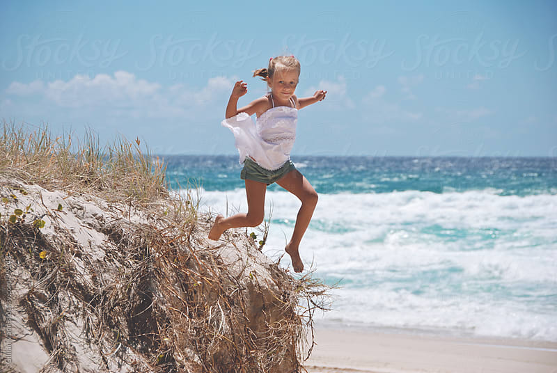 playing in the sand dunes by Gillian Vann for Stocksy United