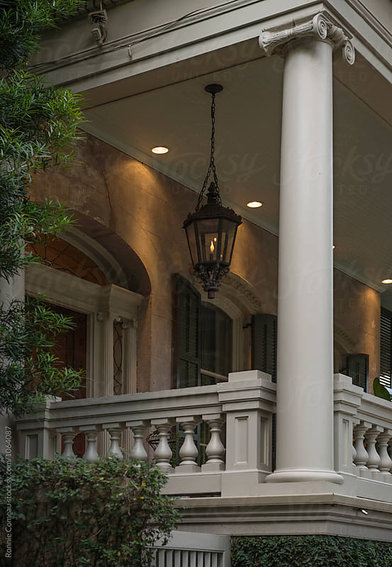 Southern Porch With Gas Lantern by Ronnie Comeau for Stocksy United