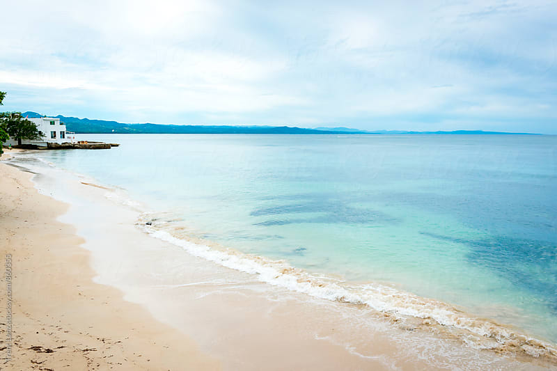 Beautiful scene of tranquil beach in blue bay by Trent Lanz for Stocksy United