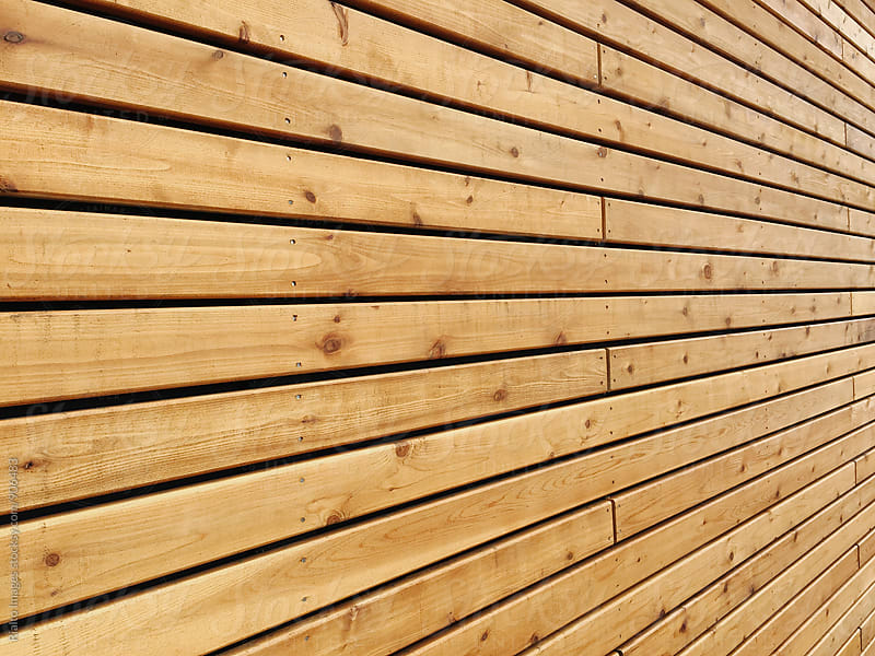 Detail of wood building wall and rows of wood planks by Paul Edmondson for Stocksy United