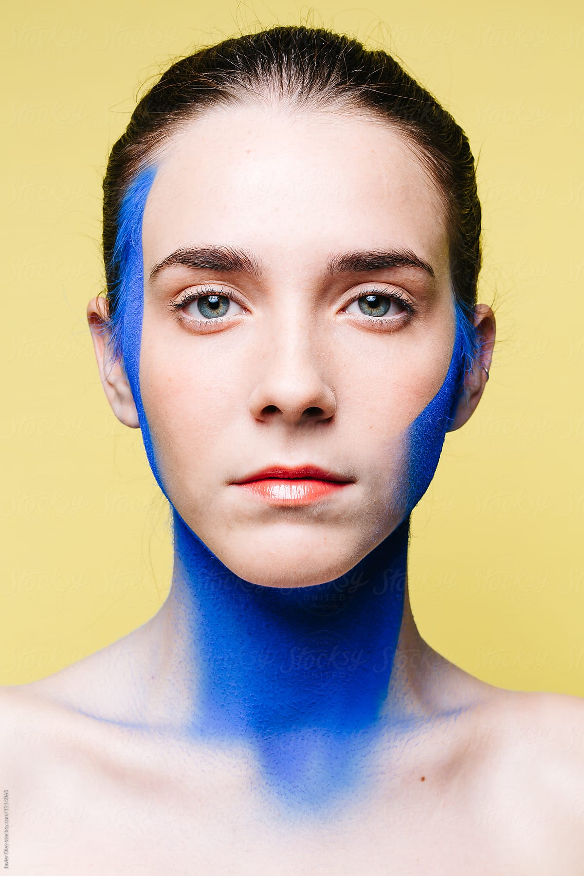 Female Model With Painted Neck And Face By Javier Diez Stocksy United