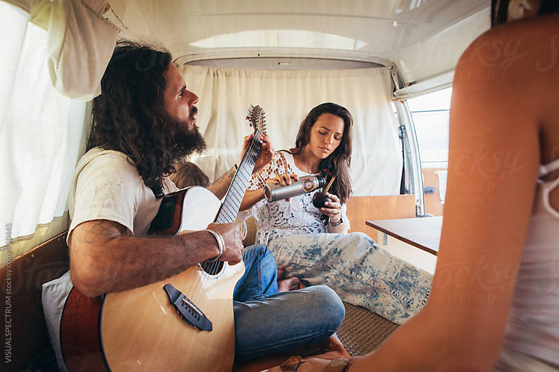 On The Road - Hippie Friends Enjoying Themselves in Stylish White Vintage Camper Van by Julien L. Balmer for Stocksy United