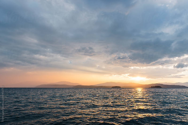 Picturesque view on lake Pend Oreille at sunset by Trent Lanz for Stocksy United