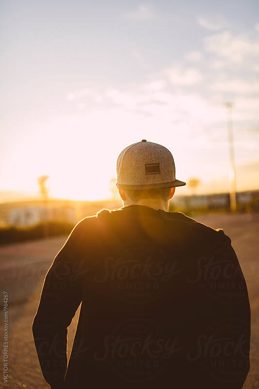 Young Man Looking at Sunset During a Bicycle Ride