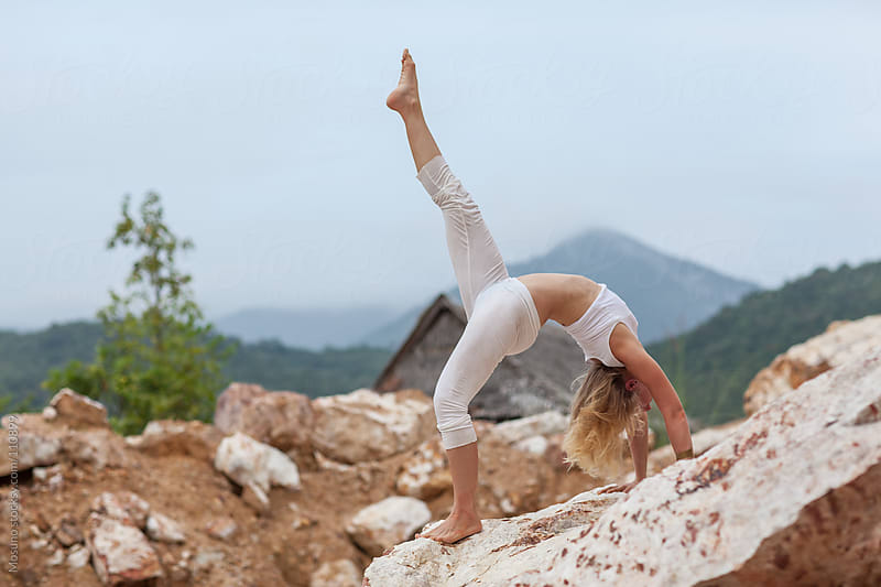 Flexible Woman Doing Yoga in Nature by Mosuno for Stocksy United