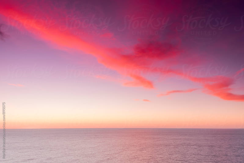Vibrant sunset over sea by Marilar Irastorza for Stocksy United