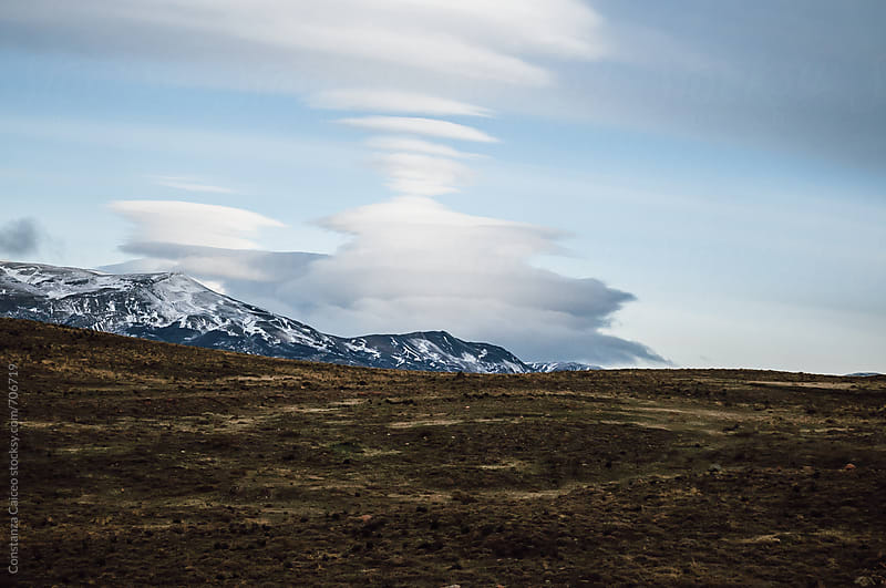 A wide cloud formation in Torres del Paine National Park  by Constanza Caiceo for Stocksy United