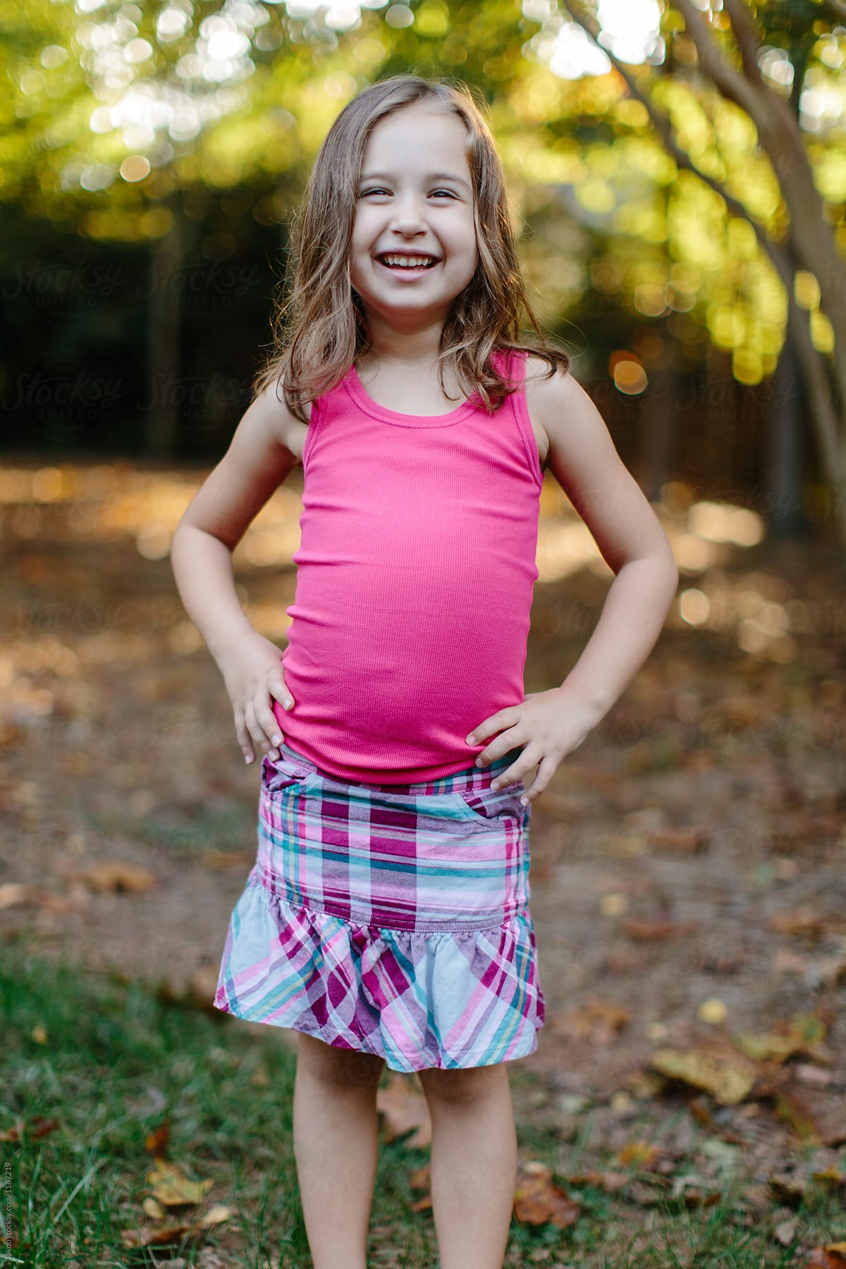 Cute Young Girl In A Skirt And Tank Top Smiling Laughing -9934