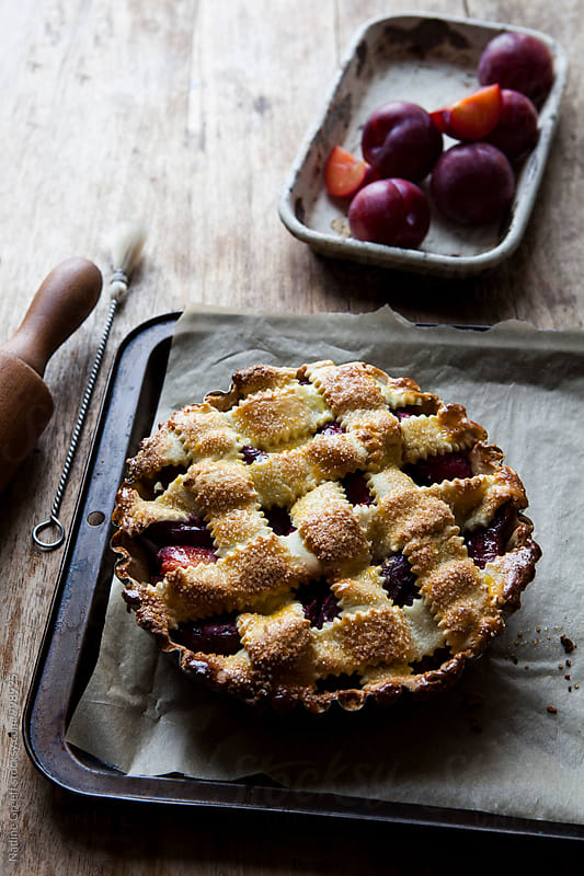 Plum pie with lattice pastry by Nadine Greeff for Stocksy United
