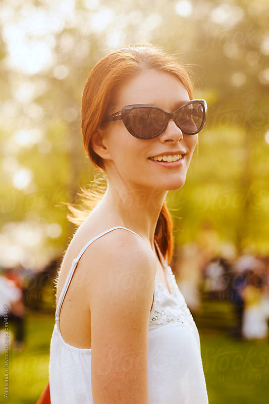 Woman with sunglasses outdoors by Aleksandra Kovac for Stocksy United