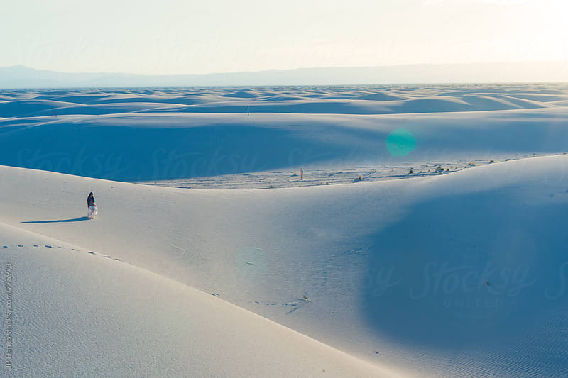 Aerial View of Woman In Skirt Walking on Sand Dunes In White Sands National Monument New Mexico by JP Danko for Stocksy United
