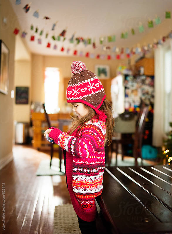 Little girl in winter clothing. by otto schulze for Stocksy United