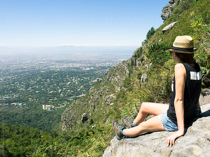 Young woman looking down Skeleton Gorge trail on Table Mountain, Capetown South Africa by DV8OR for Stocksy United