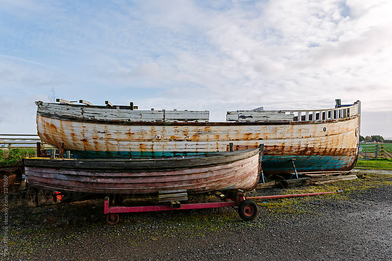 Old fishing boats out of the water for repair by Paul Phillips for Stocksy United