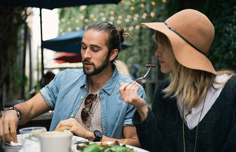 Young couple having lunch by Emmanuel Hidalgo for Stocksy United