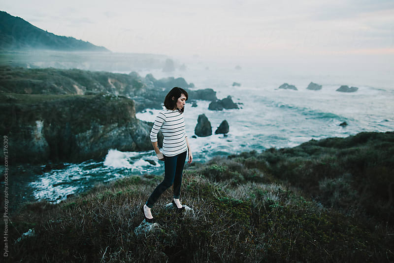 Girl on a Sea Cliff by Dylan M Howell Photography for Stocksy United
