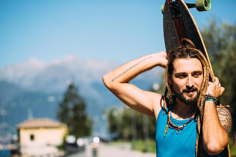 Portrait of dreadlock rasta skater by michela ravasio for Stocksy United
