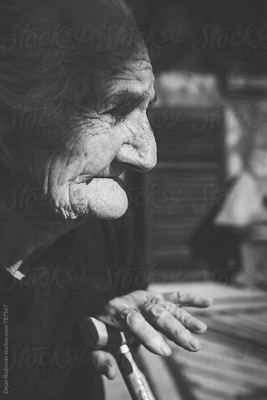 Side view of an very old woman. by Dejan Ristovski for Stocksy United