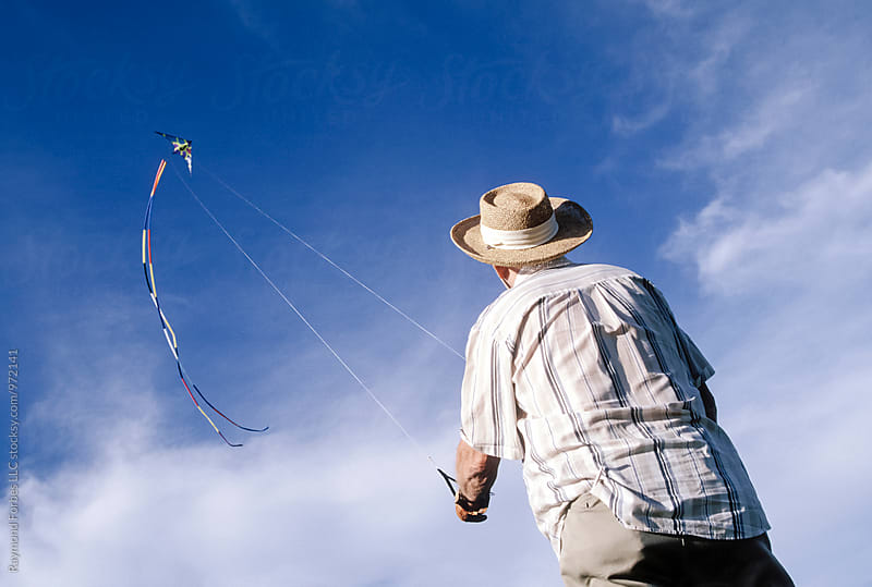 Senior Man Flying a Kite by Raymond Forbes LLC for Stocksy United