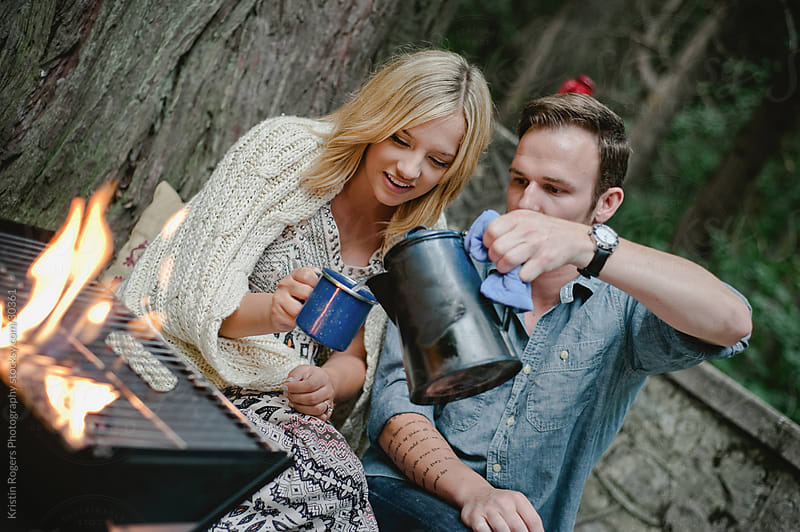Couple on romantic camping date making hot chocolate  by Kristin Rogers Photography for Stocksy United