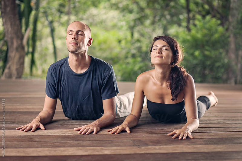 Yoga: Couple Doing Cobra Pose Together by Julien L. Balmer for Stocksy United