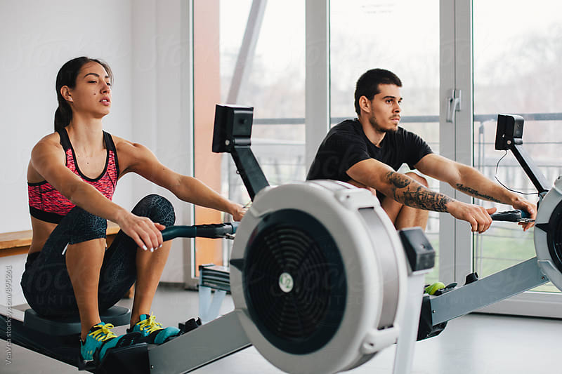 Couple having training in the gym by Marija Mandic for Stocksy United