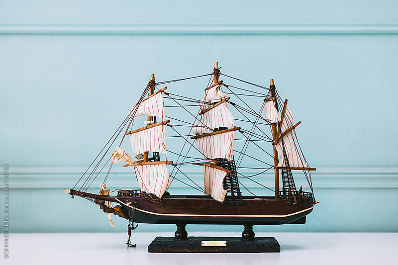 Sailboat model in front of a blue background.  by BONNINSTUDIO for Stocksy United