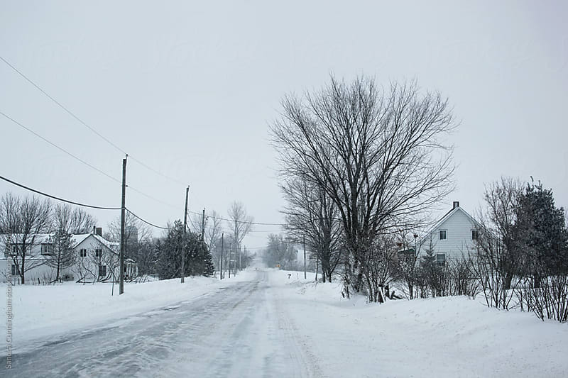 Country road  with farms during a snow storm by Sandra Cunningham for Stocksy United