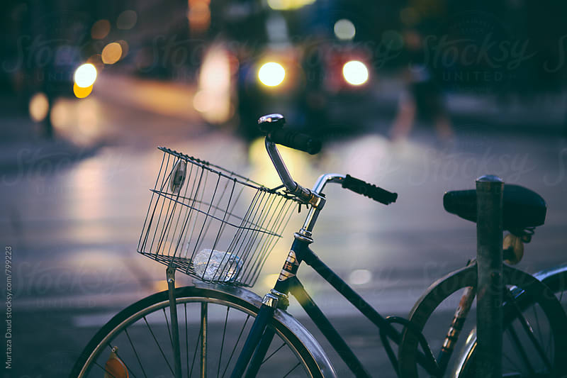 Bicycle parked in the street by Murtaza Daud for Stocksy United