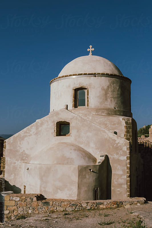 Greek old church with cross. by Alberto Bogo for Stocksy United