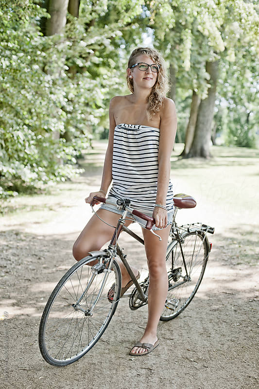 People: Young woman with bicycle on a summer day by Ina Peters for Stocksy United