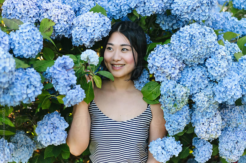 Girl with blue flowers by Sophia Hsin for Stocksy United