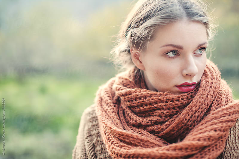 Portrait of a woman with scarf in nature by Aleksandra Kovac for Stocksy United