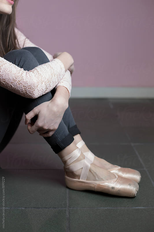 Girl with dance shoes sitting by michela ravasio for Stocksy United