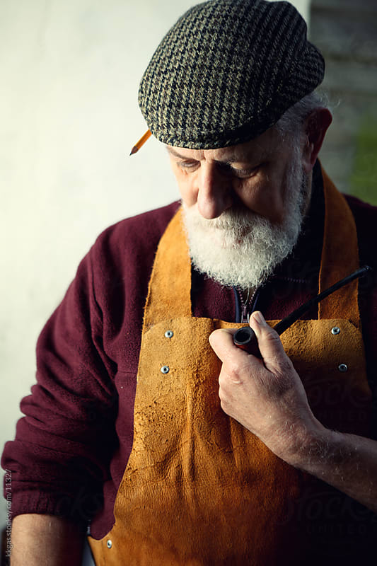 Senior carpenter with his pipe by kkgas for Stocksy United